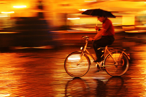 Cycling In The Rain | by Tolga Ahiska