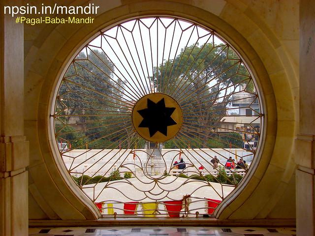 Circular window on first floor balcony, looking like Shri Vishnu sudarshan chakra. It will also increase the look of main temple.