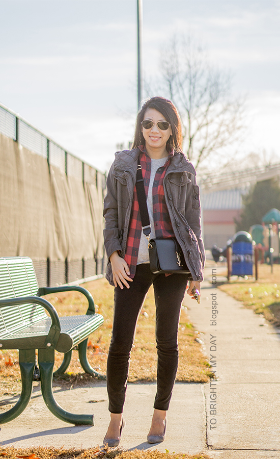 gray military jacket, red buffalo checked button up shirt, gray tee, black skinny jeans, black crossbody bag, gray suede pumps
