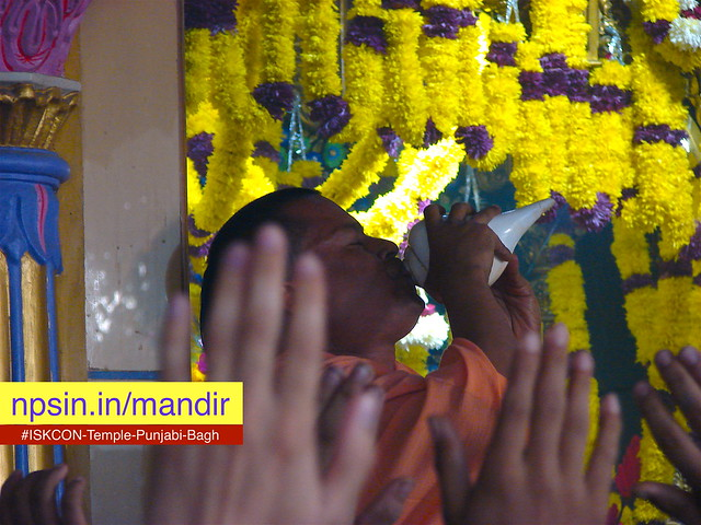Shankh naad during Shri Radha Raman Darshan Aarti. Open hand of devotees shows all are dedicated by whole.