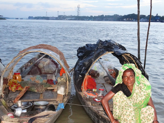 A woman catching fish, Barisal, Bangladesh. Photo by Mohammed Zakir Hossain.