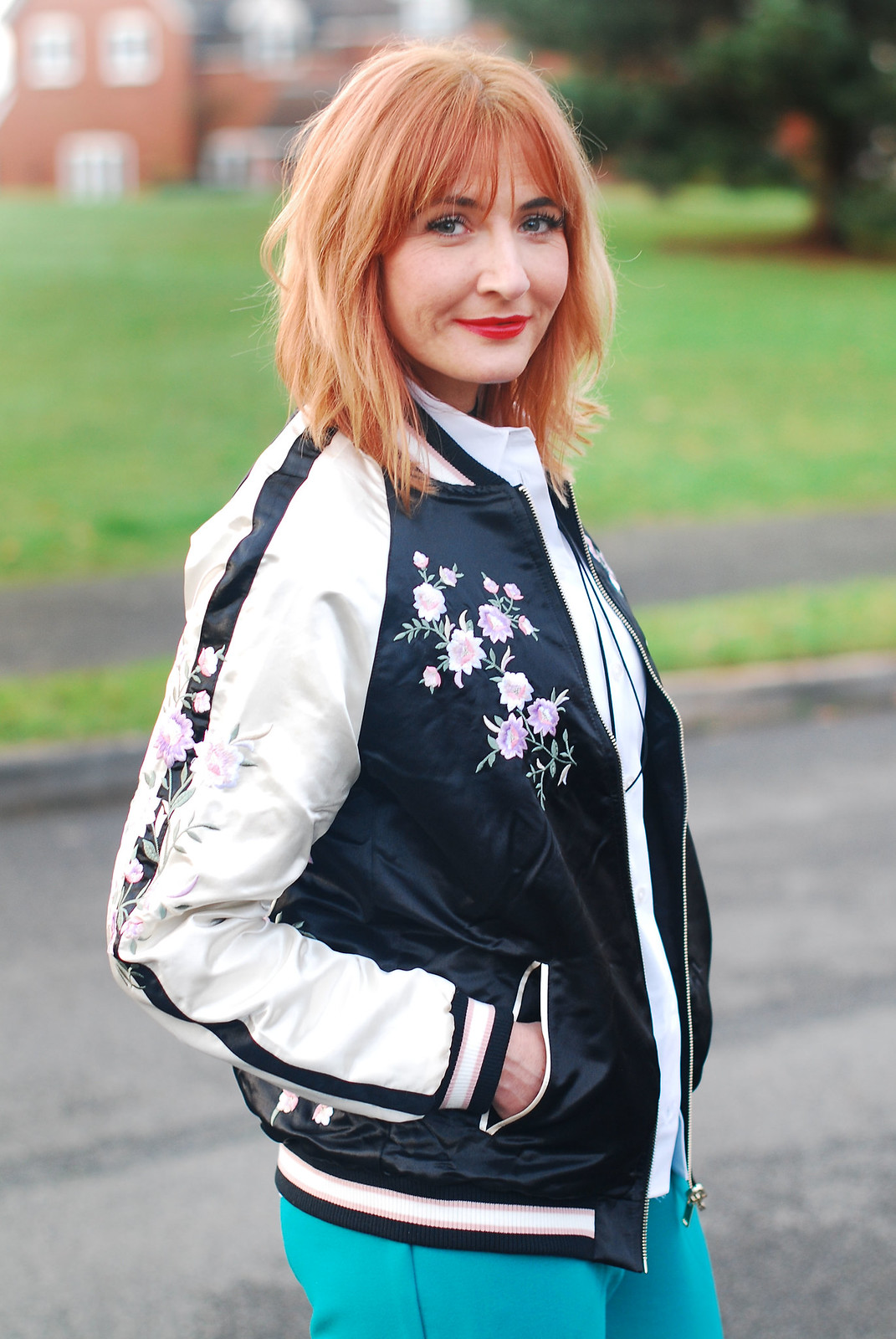 Smart casual weekend wear  floral embroidered bomber jacket  emerald green peg leg trousers  black block heel shoes  white shirt  black tie-up choker necklace | Not Dressed As Lamb, over 40 style