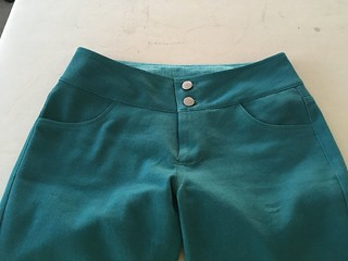 Teal jeans - front closeup