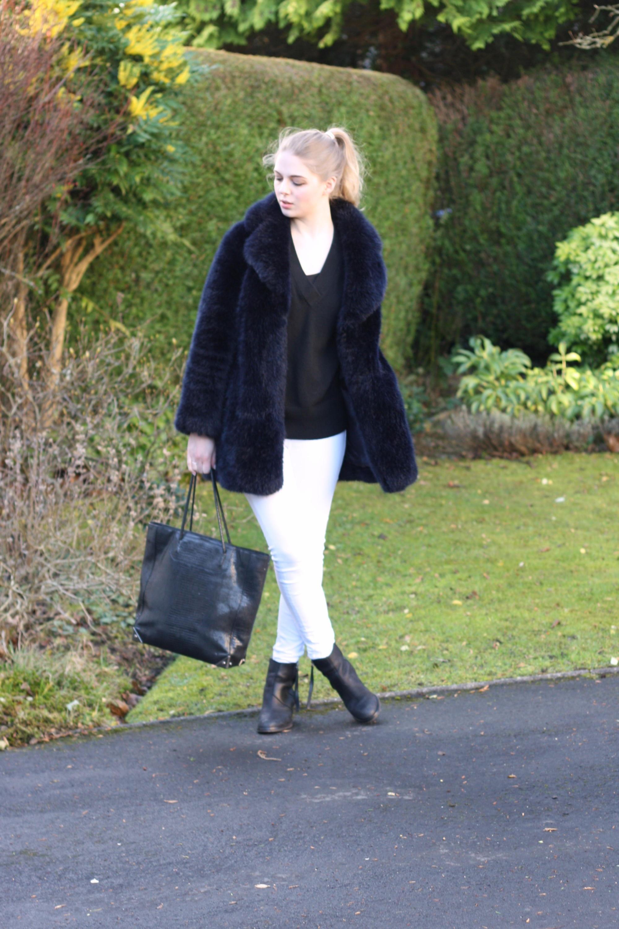 & Other Stories black cashmere jumper, white Topshop Jamie jeans and Alexander Wang Prisma bag