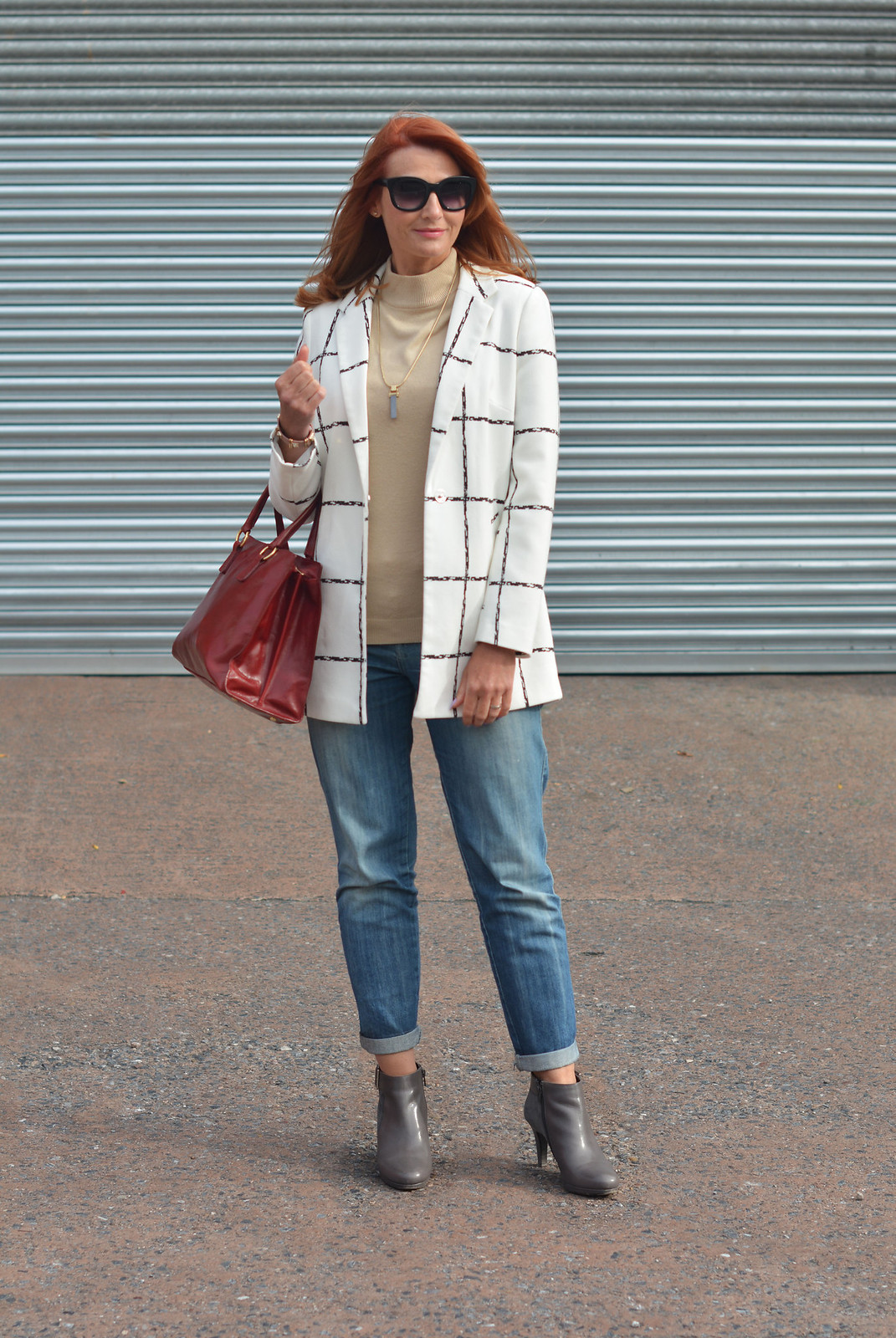 Black and white window-pane check coat, boyfriend jeans, grey booties