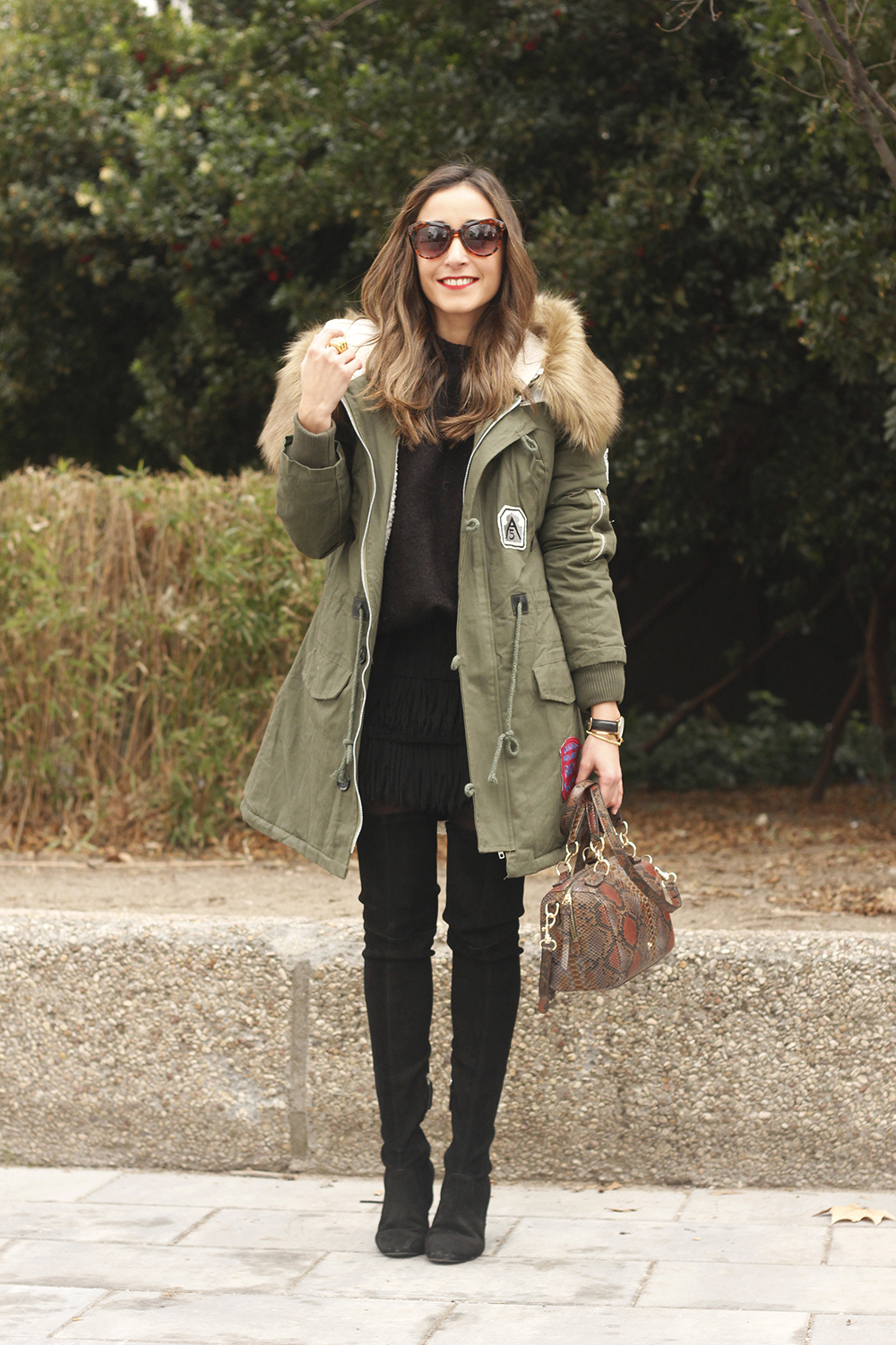 Green Parka black skirt over the knee boots winter style outfit01
