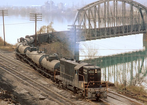Pittsburgh and Lake Erie local freight, powered by 1500 hp EMD GP-7 5733, leaving Neville Island, and entering McKees Rocks, PA, after crossing the back channel of the Ohio River, October, 1971 | by Ivan S. Abrams