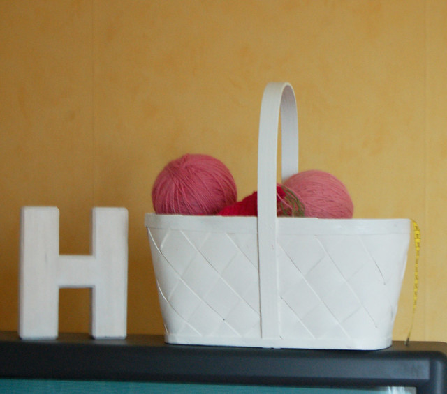 My wooden H made by Maria + yarn on top of the television - photo copyright Hanna Andersson