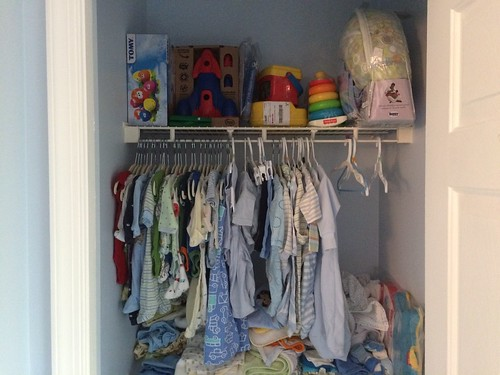 Nursery Closet with Baby Clothes