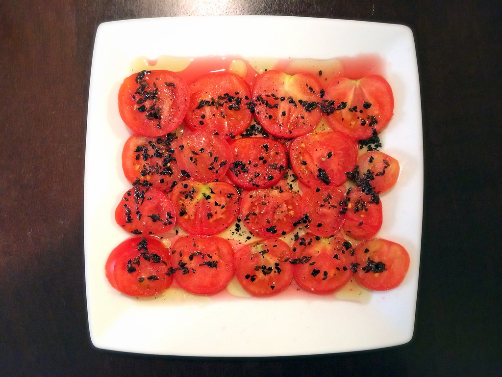 Tomatoes in chile-fennel oil