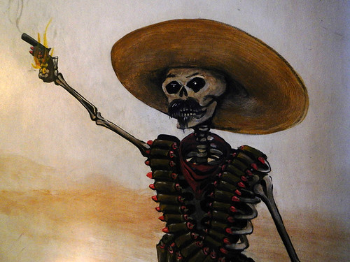 A mural of a skeleton shoot out decorates the wall of Los Muertos Craft Brewery in Puerto Vallarta, Mexico