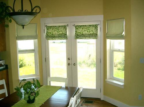 Bay windows roman shades the french door shades don 39 t for Roman shades for bay windows