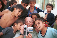 Photographer takes and shows digital video images of himself and young children. Tajikistan | by World Bank Photo Collection