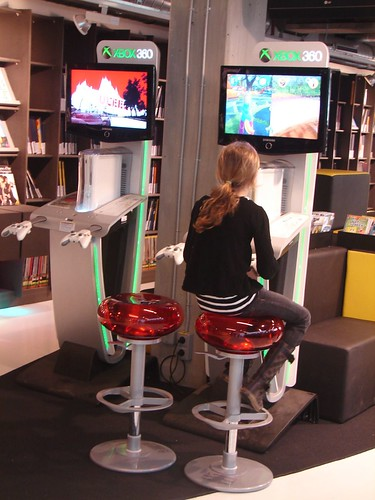 young lady playing with a new Xbox kiosk | by The Shifted Librarian