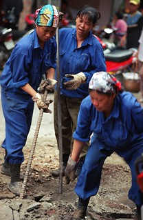Women repairing a road in Hanoi | by World Bank Photo Collection