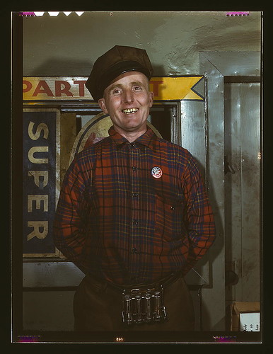 Garage mechanic near Newark, N.J. Badge denotes member of Office of Defense Transportation  (LOC) | by The Library of Congress