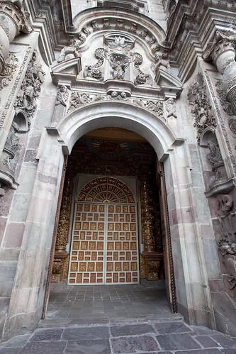 Quito | Jesuit church door. The interior is full of gold ...
