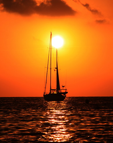 Sail Boat Anchored at Sunset | by S@ilor