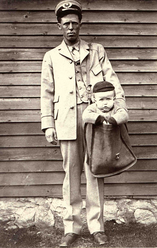 Uniformed Letter Carrier with Child in Mailbag | by Smithsonian Institution