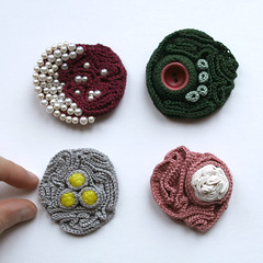 Four crochet brooches | by ulaniulani