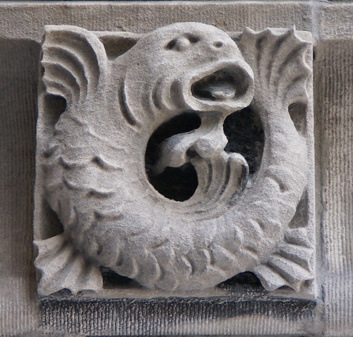 Fish carved relief sculpture of a from frieze on