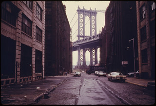 Manhattan Bridge Tower in Brooklyn, New York City, Framed through Nearby Buildings...06/1974 | by The U.S. National Archives