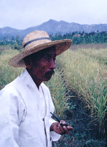 Man in Traditional Dress & Straw Hat, 1968 | by Homer 5004