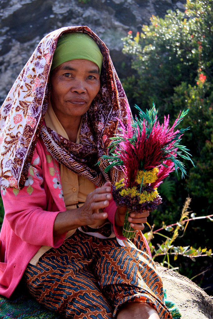 A Woman Selling Offerings To Appease Mount Bromo