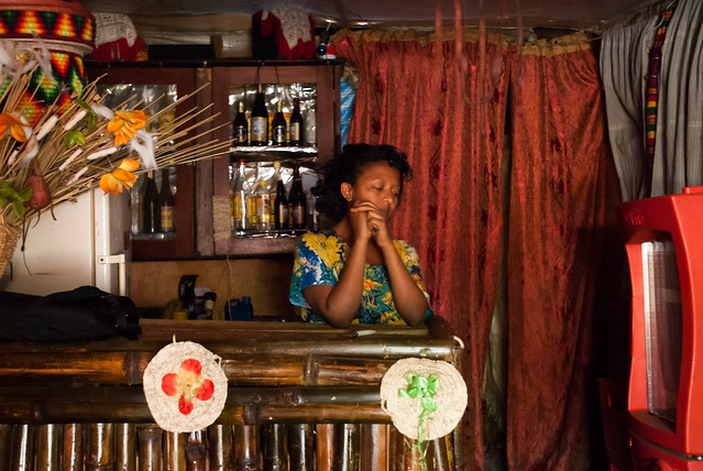Haregua Askale stands in her traditional bar waiting for customers