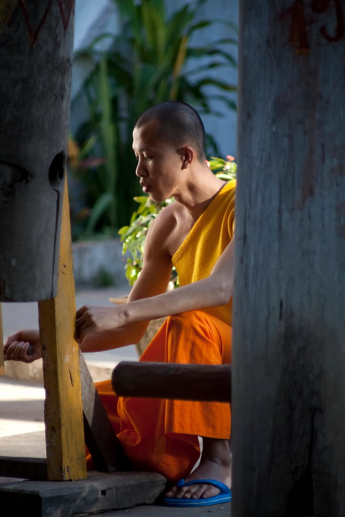 A Monk In Laos Working