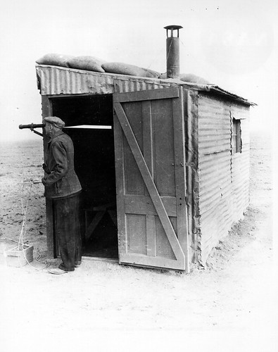 Dr robert h goddard at his launch control shack by nasa on the