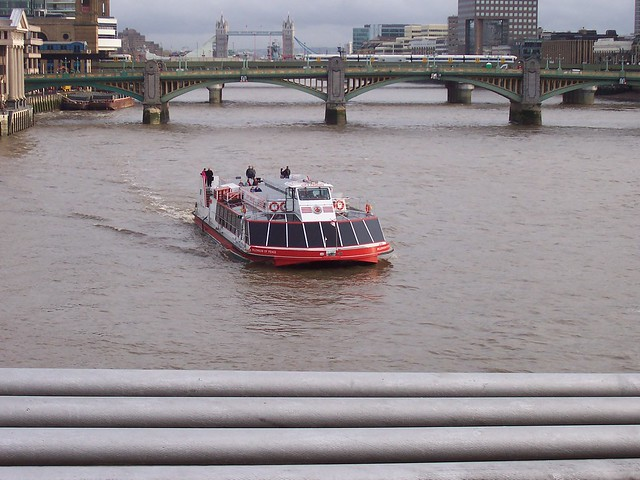 Thames River with scenic cruise tour boat