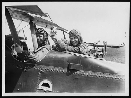 Cheery pilot and observer with their mascot pup ready for a flight over the German lines | by National Library of Scotland