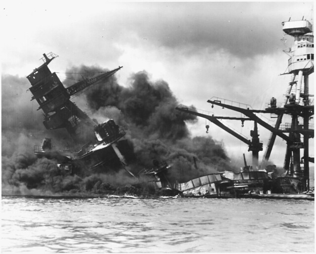 Naval photograph documenting the Japanese attack on Pearl Harbor, Hawaii which initiated US participation in World War II. Navy's caption: The battleship USS ARIZONA sinking after being hit by Japanese air attack on Dec. 7,1941., 12/07/1941