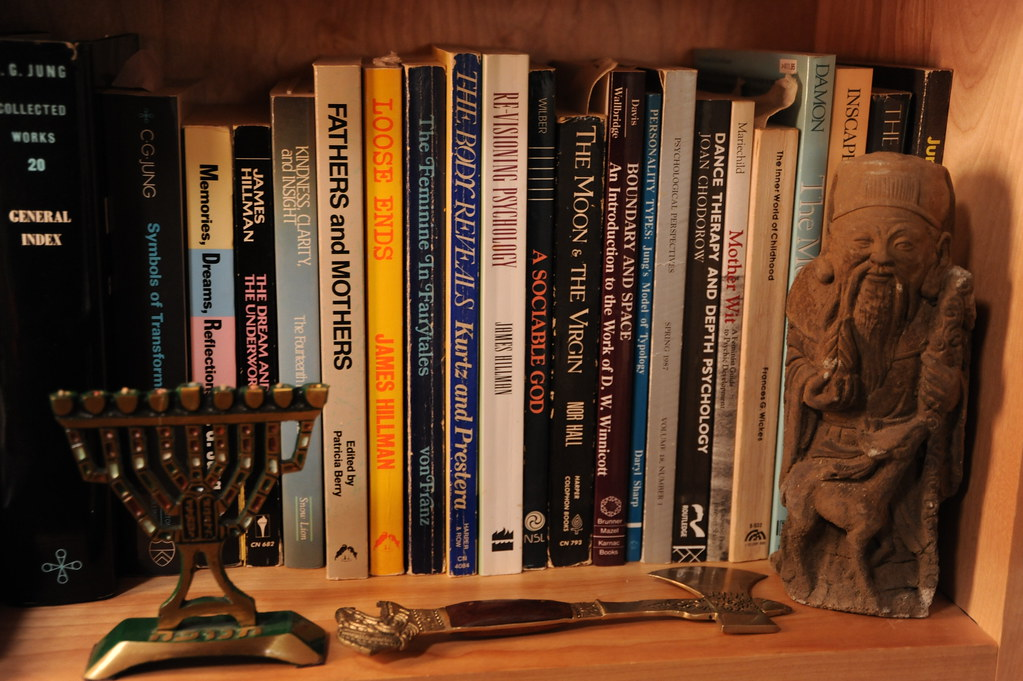 Jewish Menorah, Confucius statue, miniature axe, books on a shelf, MIRACLES: Past, Present, Future; science, art, religion, medicine, Wu Hsing Tao Acupuncture School, Seattle, Washington, USA