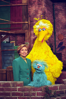 Photograph of First Lady Hillary Rodham Clinton Posing on the Big Bird Nest Set with Big Bird... | by The U.S. National Archives