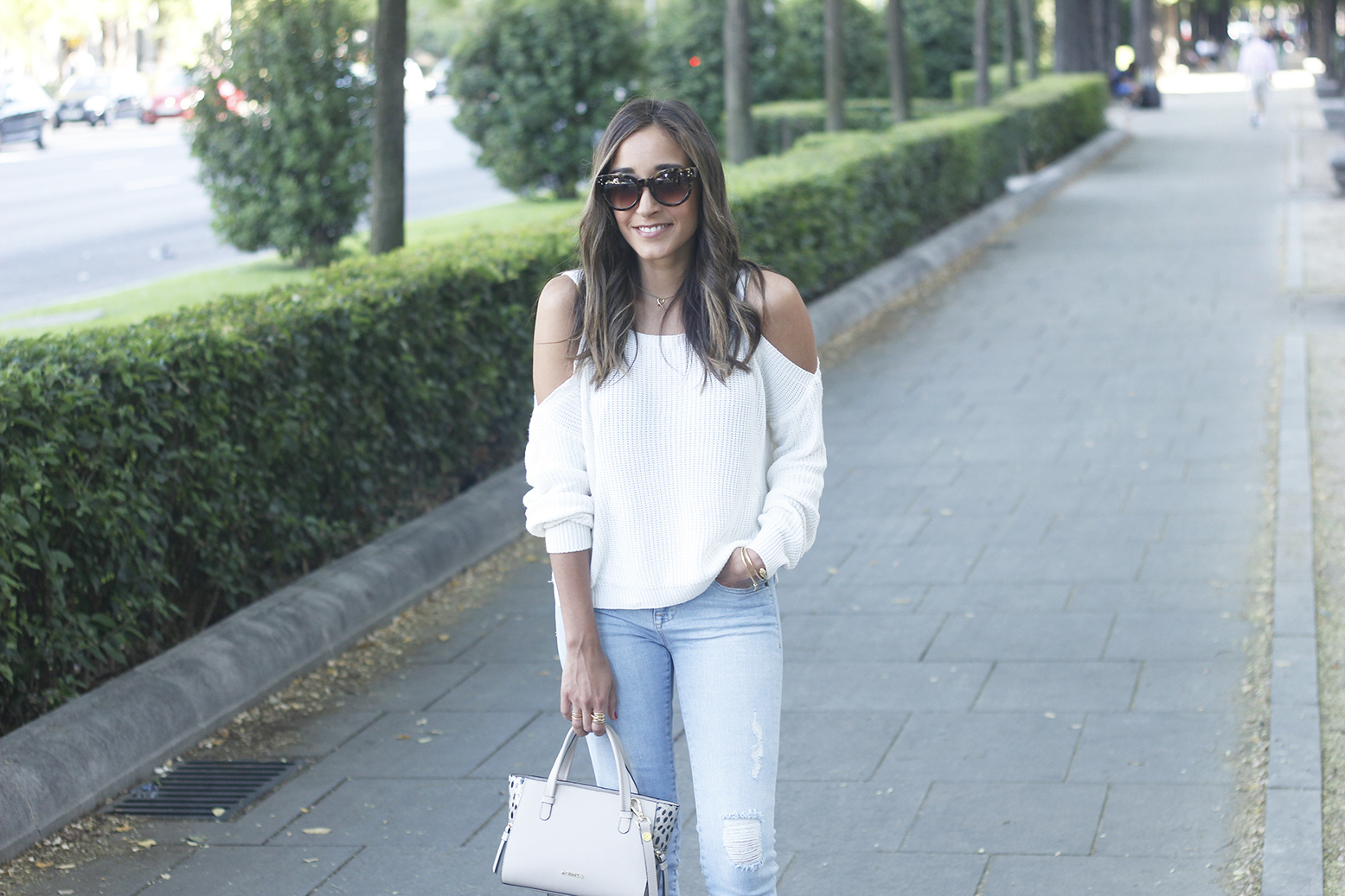 White off the shoulder sweater jeans acosta bag heels outfit style14