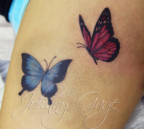 butterflies on thigh tattoo | by johnny gage