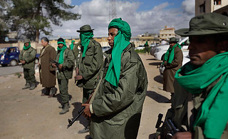 Libyan military forces stand guard at a checkpoint to guard against the counter-revolutionary forces that are backed by U.S. imperialism and its allies. The patriots have made significant headway in defeating the rebels. | by Pan-African News Wire File Photos