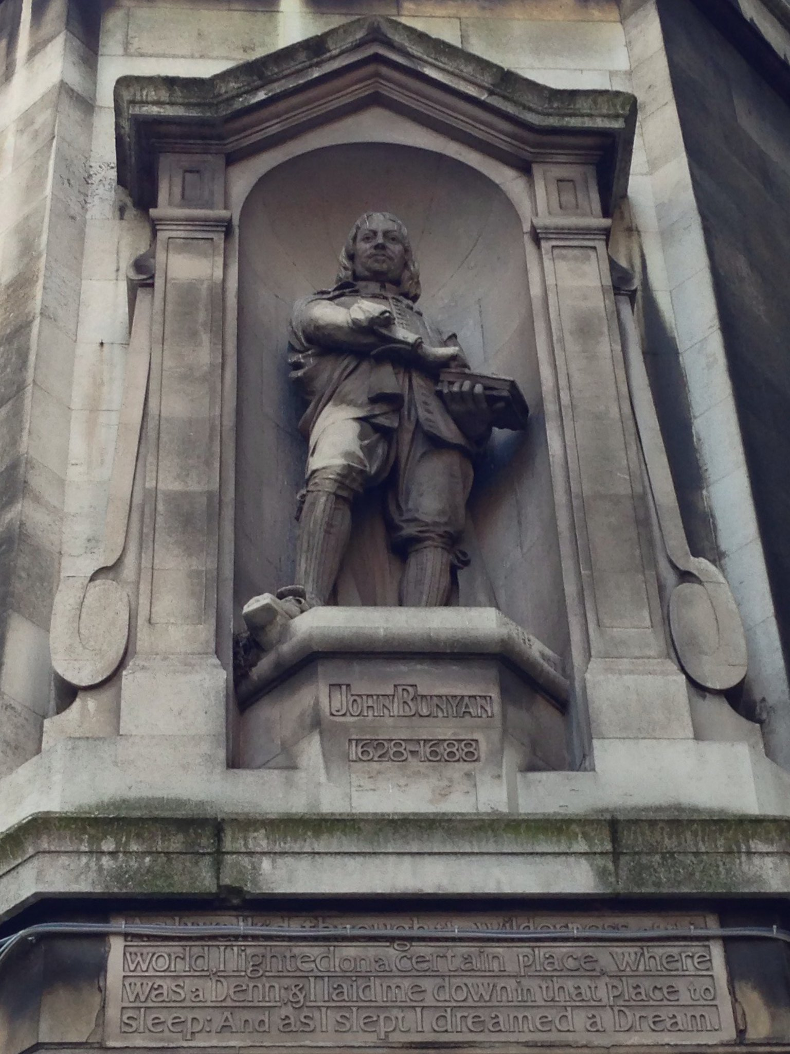 Statue of John Bunyan, author of A Pilgrim's Progress, on the corner of Catton Street, Holborn.