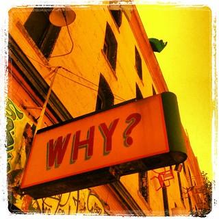 Sign on Defenestration Building Asks Why?