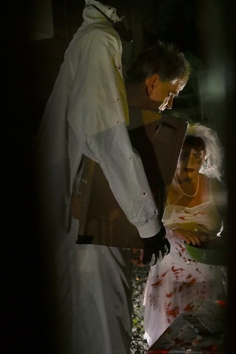 man with his head in a box and his bloodied bride. Halloween 2016 at Woodgrove, Woodlands, Singapore