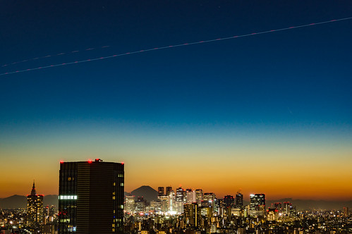 Shinjuku skyscrapers, the trajectory of the airplane
