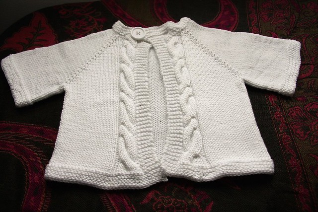 Cabled baby raglan sweater