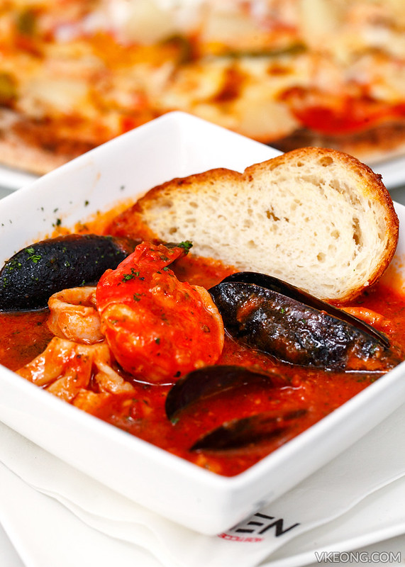 Fresh mussels squid prawns and fish tomato soup