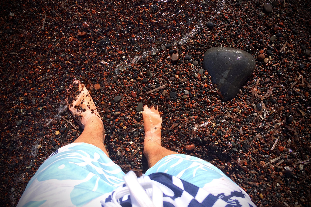 Feet on Red Sand Beach