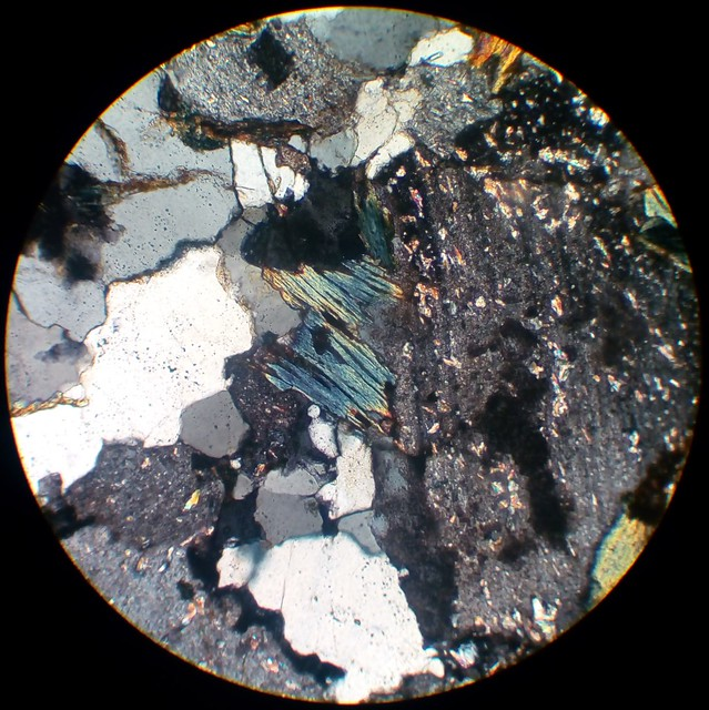 Chlorite pseudomorph after biotite (30 µm thin section, XPL)