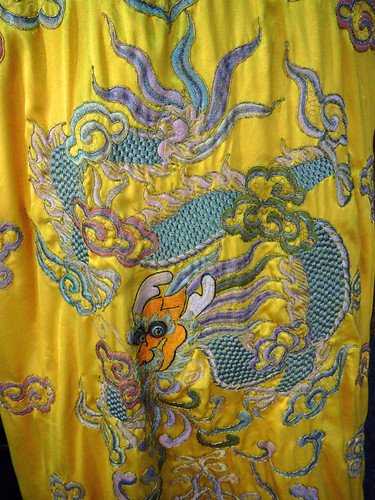 A swirling dragon embroidered on a royal yellow gown in Hoi An, Vietnam