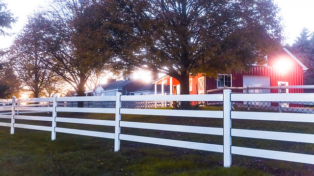 Sunsets on Red Barn and White Fence