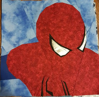 Paper pieced SPIDERMAN. Pattern on fandominstitches. Pieced by Hannah Hughes.